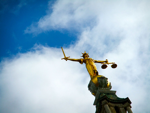 an image showing the statue of justice to illustrate